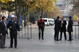 Turkish police take security measures on a road leading to Prime Minister Tayyip Erdogan's offices in Ankara, Nov. 21, 2013.