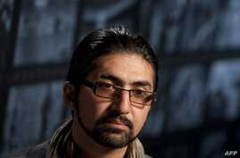 FILE - Massoud Hossaini sits for an interview following a discussion of his Pulitzer Prize-winning photograph at the Newseum in Washington, May 24, 2012. Hossaini, who has been working for the Associated Press in Kabul, said he survived what he calle