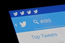 FILE - The Islamic State hashtag (#ISIS) is seen typed into the Twitter application on a smartphone in this picture illustration taken in Zenica, Bosnia and Herzegovina.