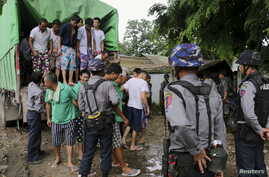 Chinese nationals, believed to be involved in illegal logging, arrive at a court in Myitkyina, capital of Kachin State in the north of Myanmar, July 22, 2015.