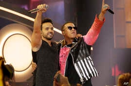 "FILE - This April 27, 2017, photo shows singers Luis Fonsi, left, and Daddy Yankee during the Latin Billboard Awards in Coral Gables, Florida. The success of their hit song ""Despacito,"" has stretched beyond its Latin audience, becoming the year's m..."