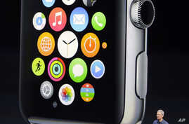 Apple CEO Tim Cook introduces the new Apple Watch in Cupertino, Calif., Sept. 9, 2014,
