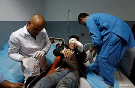 An injured man receives treatment at a hospital after a suicide attack in Kabul, Afghanistan, Nov. 21, 2016.