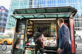 FILE - A misinformation newsstand is seen in midtown Manhattan on Oct. 30, 2018, aiming  to educate news consumers about the dangers of disinformation, or fake news, in the lead-up to the US midterm elections. The newsstand was set up by the Columbia