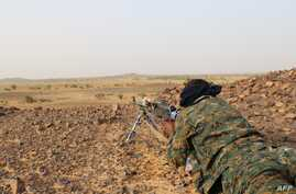 A Tuareg fighter of the Coordination of Movements of the Azawad (CMA) points his weapon near Kidal, northern Mali, Sept. 28, 2016,