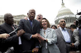 """From left, House Assistant Minority Leader James Clyburn, Rep. John Lewis, D-Ga., Rep. Joseph Crowley, D-N.Y., House Minority Leader Nancy Pelosi of California, and Rep. Charles Rangel, D-N.Y., sing """"We Shall Overcome"""" on Capitol Hill, in Washington,"""