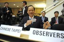 FILE - Taiwan's health minister Ching-Chuan Yeh shows his badge at the World Health Assembly in Geneva, Switzerland, May 18, 2009.