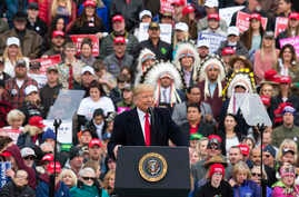 President Donald Trump speaks during a campaign rally at Bozeman Yellowstone International Airport, Nov. 3, 2018, in Belgrade, Montana.