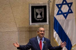 """File - Israeli Prime Minister, Benjamin Netanyahu, gestures during a speech at the Knesset, Oct. 31, 2016. Israel's Justice Ministry and police issued a statement Dec. 28, 2016, that said they will issue an update """"in due time"""" about an ongoing probe"""
