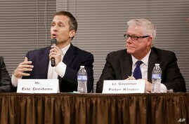 FILE - In this Nov. 3, 2015, photo, Missouri Republican gubernatorial candidates, former Navy SEAL Eric Greitens, left, and Lt. Gov. Peter Kinder participate in a forum in Jefferson City, Missouri.