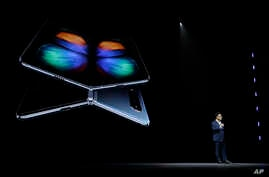DJ Koh, Samsung President and CEO of IT and Mobile Communications, talks about the new Samsung Galaxy Fold smartphone during an event, Feb. 20, 2019, in San Francisco.
