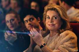 French actress Catherine Deneuve, president of the Premiers Plans film festival, applauds during the festival's opening session in Angers, western France, Jan. 15, 2018, .