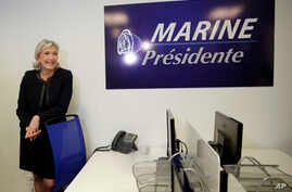 Trump effect and French elections: Far-right leader Marine le Pen poses as she inaugurates her campaign headquarters, Wednesday, Nov.16, 2016 in Paris. Le Pen is convinced that her anti-immigration, anti-Islam views can lead her to the presidency in ...