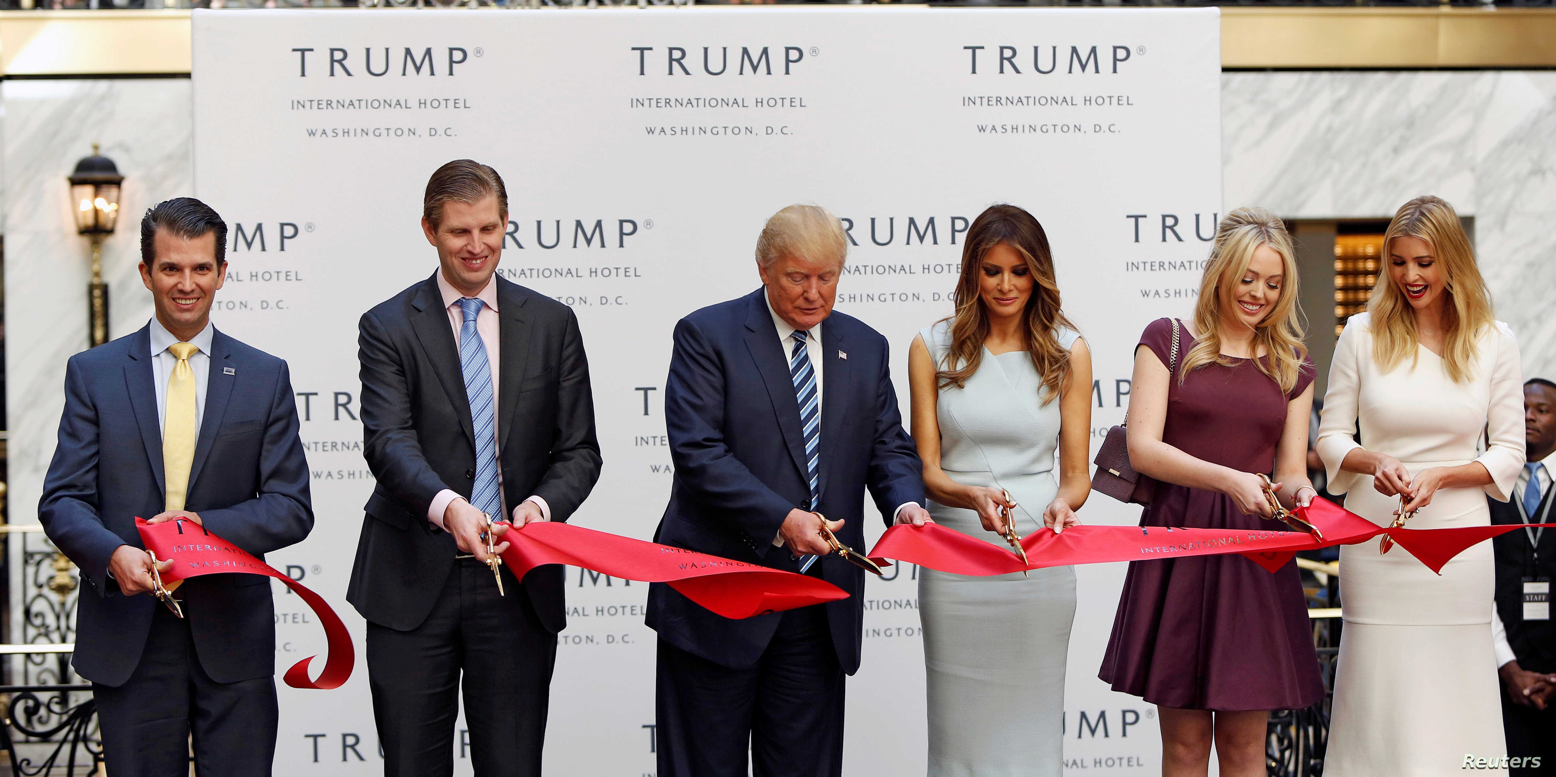 (L-R) Donald Trump Jr., Eric Trump, then-Republican U.S. presidential nominee Donald Trump, Melania Trump, Tiffany Trump and Ivanka Trump attend an official ribbon cutting ceremony at the new Trump International Hotel in Washington U.S., Oct. 26, 201