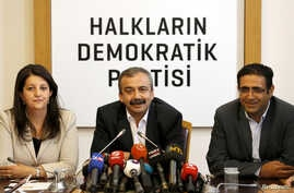 FILE - Pro-Kurdish politicians of Peoples' Democratic Party (HDP) Pervin Buldan (left) Sirri Sureyya Onder (center) and Idris Baluken attend a news conference in Ankara, Turkey, June 12, 2015.
