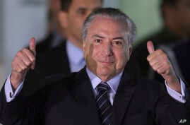 Brazil's President Michel Temer flashes two thumbs up as he leaves the Military Hospital, in Brasilia, Brazil, Oct. 25, 2017. Temer survived a key vote Wednesday night on whether he should be tried on corruption charges.