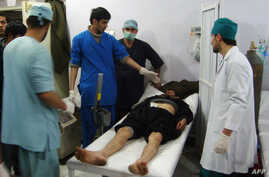 Medical staff assist a victim of the blast at the main hospital in Kunduz January 26, 2013.