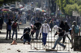 Student demonstrators are seen during a protest supporting a nationwide agriculture strike in Bogota, Colombia, April 28, 2014.