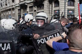Riot police clash with protesters in Belgrade, Serbia, Sunday, March 17, 2019.