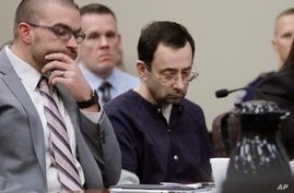 Larry Nassar sits with attorney Matt Newburg during his sentencing hearing, Jan. 24, 2018, in Lansing, Mich.