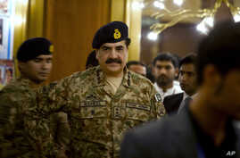 FILE - Pakistan's Army Chief General Raheel Sharif is seen arriving at a seminar in Gwadar, a town about 700 kilometers (435 miles) west of Karachi, Pakistan, April 12, 2016. On Thursday Sharif reportedly dismissed 11 top officers for corruption.