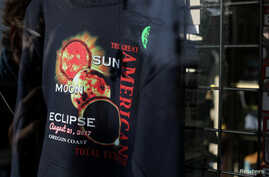 Eclipse T-shirts are shown for sale in store windows as the small town of Depoe Bay, Oregon, U.S., prepares for the coming solar eclipse,  Aug. 19, 2017.
