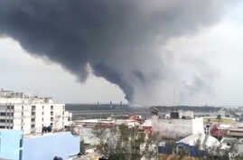 In this video grab a large plume of smoke rises from the Mexican State oil company Petroleos Mexicanos' petrochemical plant after an explosion in Coatzacoalcos, Mexico, Wednesday, April 20, 2016.