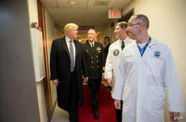 President Donald J. Trump talks with, from left to right, with Capt. Mark Kobelja, director of Walter Reed National Military Medical Center; Dr. Ronny Jackson, physician to the president; and Dr. James Jones, physician to the president and medical di