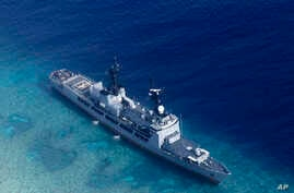 FILE - In photo provided by the Armed Forces of the Philippines, Aug. 29, 2018, shows the Philippine Navy ship BRP Gregorio del Pilar after it ran aground during a routine patrol in the vicinity of Half Moon Shoal, which is called Hasa Hasa in the Ph