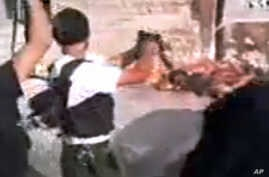 This image made from amateur video released by Tabshoor1 and accessed July 31, 2012, purports to show Free Syrian Army soldiers executing Assad loyalists in Aleppo, Syria.  THE ASSOCIATED PRESS IS UNABLE TO INDEPENDENTLY VERIFY THE AUTHENTICITY, CONT