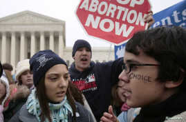 FILE - A pro-choice supporter is confronted by pro-life supporters at a rally in front of the U.S. Supreme Court in Washington January 22, 2007.