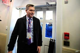 CNN's Jim Acosta enters the Brady press briefing room upon returning to the White House in Washington, Nov. 16, 2018.
