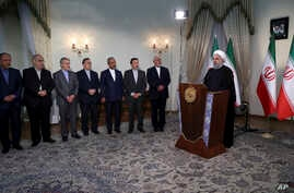 In this photo released by official website of the office of the Iranian presidency, President Hassan Rouhani addresses the nation in a televised speech in Tehran, May 8, 2018. Rouhani said he'd send his foreign minister to negotiate with countries re...