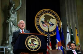 Attorney General Jeff Sessions speaks during a Religious Liberty Summit at the Department of Justice, July 30, 2018. Seated on the right is Deputy Attorney General Rod Rosenstein.