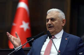 Binali Yildirim, who replaces the outgoing prime minister, Ahmet Davutoglu, addresses his lawmakers at the parliament in Ankara, Turkey, May 24, 2016.