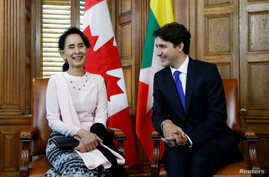 Canada's Prime Minister Justin Trudeau (R) meets with Myanmar State Counsellor Aung San Suu Kyi