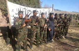 This photo released in a statement by the Pakistani Taliban shows the fighters who stormed a military-run school in Peshawar, Pakistan, Dec. 16, 2014.