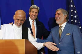 Afghan presidential candidate Abdullah Abdullah, from right, U.S. Secretary of State John Kerry and Afghan presidential candidate Ashraf Ghani Ahmadzai share a light moment at the podium during a joint press conference in Kabul, Afghanistan, Aug. 8,