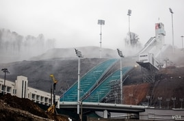 The Olympic ski jump rises from the mountain mists above Sochi, Russia, March 17, 2013. (V. Undritz/VOA)