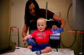 Kilian Daugherty, 1, is prepped for a chest X-ray by radiology technologist Kerah Adams as he's examined for flu symptoms at Upson Regional Medical Center in Thomaston, Ga., Feb. 9, 2018.