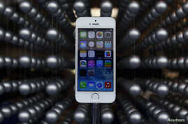 Apple's new iPhone 5S is displayed at an Apple shop in Tokyo's Ginza shopping district, Japan, Sept. 20, 2013.