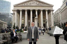 In this photo taken Nov. 2, 2017, Hubertus Vaeth, the managing director of Frankfurt Main Finance poses for a portrait outside the Royal Exchange in the City of London. With London-based banks, insurers and asset managers all scrambling to prepare fo