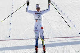 Sweden's Charlotte Kalla celebrates as she finishes third in the women's skiathlon 7.5 km classic at the 2017 Nordic Skiing World Championships in Lahti, Finland, Feb. 25, 2017.