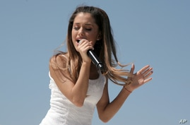 Recording artist Ariana Grande attends the Born Free Mother's Day Carnival, May 11, 2014, in New York.