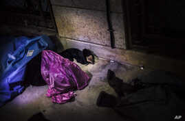 The body of a Syrian woman is seen near Izaz's Hospital after being shot by a sniper in the countryside around Izaz, near the Turkish border with Syria, Oct. 1, 2012.
