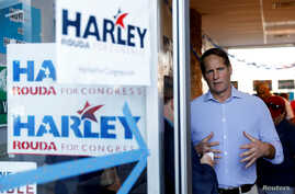 Democratic congressional candidate Harley Rouda speaks to a reporter at a campaign office in Costa Mesa, California, Nov. 3, 2018.