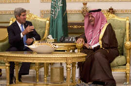 U.S. Secretary of State John Kerry, left,  talks with Saudi Foreign Minister Prince Saud Al-Faisal bin Abdulaziz al-Saud, after Kerry arrived in Riyadh, Saudi Arabia, Nov. 3, 2013.