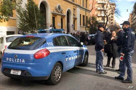 Italian police stand by an evacuated school after three earthquakes hit central Italy in the space of an hour, shaking the same region that suffered a series of deadly quakes last year, in Rome, Jan. 18, 2017.