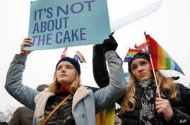 Lydia Macy, 17, left, and Mira Gottlieb, 16, both of Berkeley, Calif., rally outside of the Supreme Court, which is hearing the Masterpiece Cakeshop v. Colorado Civil Rights Commission, Dec. 5, 2017, in Washington.