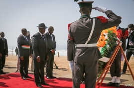 Ivory Coast's President Alassane Ouattara prepares to lay a wreath for those killed in Sunday's attack on a beach in Grand Bassam, March 16, 2016. (E. Iob/VOA)